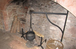 Medieval cooking pot in fireplace