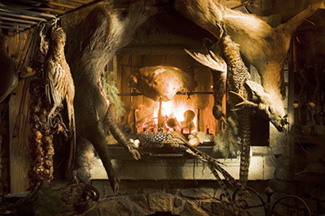 Medieval meat roasting in an open fireplace
