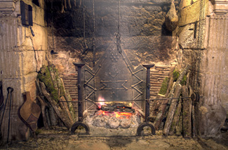 Open hearth fireplace where food was cooked